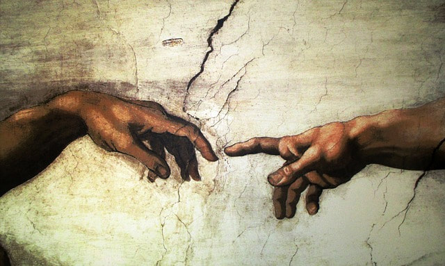 close up of the fingers touching in the Sistine Chapel